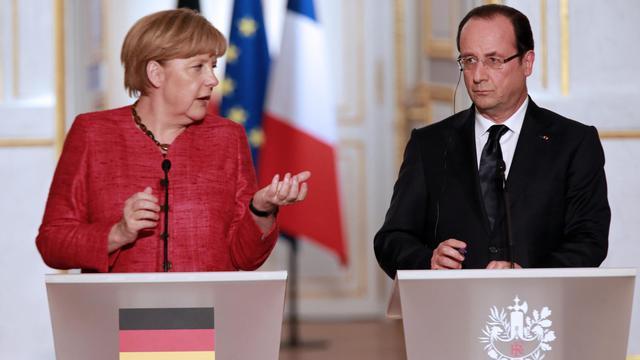 La chancelière allemande Angela Merkel et le président français François Hollande, le 30 mai 2013 à l'Elysée [Pierre Verdy / AFP]