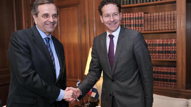 Le premier ministre grec Antonis Samaras et le patron de l'Eurogroupe, Jeroen Djisselbloem, le 31 mai 2013 à Athènes [Louisa Gouliamaki / AFP]