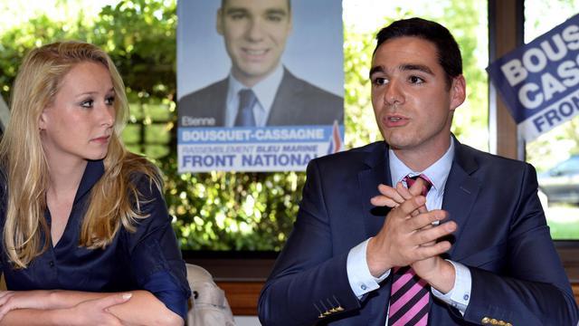 Le candidat FN dans le Lot-et-Garonne Etienne Bousquet-Cassagne (d) et Marion Maréchal-Le Pen, le 3 juin 2013 à Pujols [Jean-Pierre Muller / AFP/Archives]