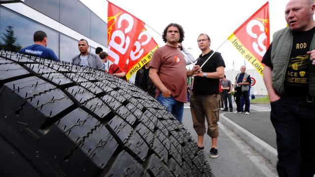 Des salariés de l'usine Michelin de Joué-lès-Tours (Indre-et-Loire), le 10 juin 2013 [Jean-Francois Monier / AFP]