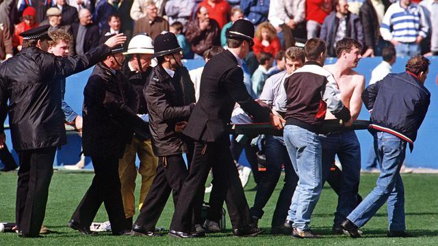 Vingt-trois ans après, les proches des 96 supporters du club de football de Liverpool morts dans une bousculade au stade de Hillsborough à Sheffield espéraient mercredi connaître enfin la vérité sur l'efficacité des secours et de la police, grâce à la divulgation de documents secrets. [AFP]