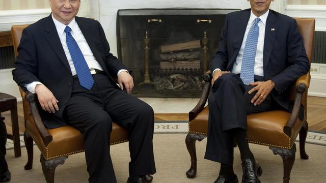 Le président Barack Obama et son homologue chinois Xi Jinping, le 14 février 2012 à Washington [Saul Loeb / AFP/Archives]