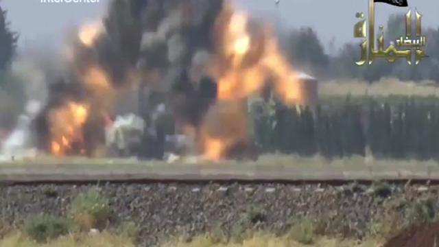 Capture d'écran d'une vidéo diffusée le 19 septembre 2012 par IntelCenter, affirmant montrer une attaque rebelle contre des miliciens pro-Assad près de Hama [ / IntelCenter/AFP]