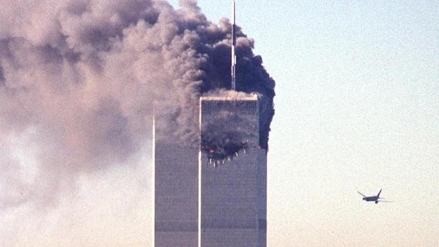 Un avion s'apprête à percuter le World Trade Center pour la seconde fois, à New York, le 11 septembre 2001 [Seth Mcallister / AFP/Archives]