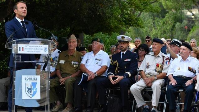 Cérémonie à l'occasion du 75e anniversaire de la libération de Bormes-les-Mimosas, en présence d'Emmanuel Macron, le 17 août 2019 [Yann COATSALIOU / POOL/AFP]