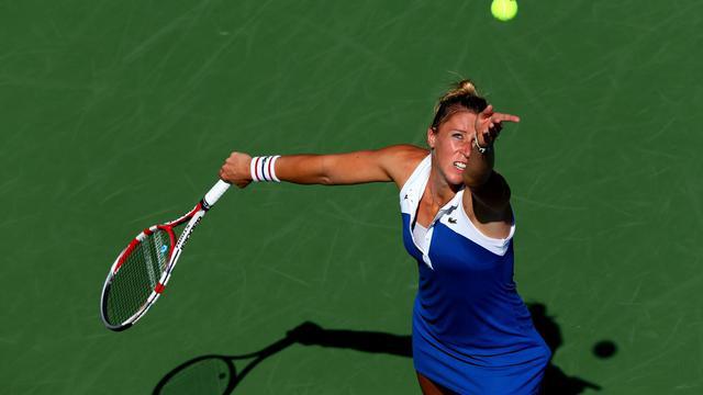 La Française Pauline Parmentier contre la Tchèque Petra Kvitova, à l'US Open, le 31 août 2012 à New York. [Elsa / AFP/Getty Images]