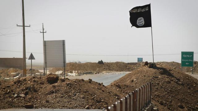 Un drapeau du groupe jihadiste Etat islamique, le 11 septembre 2014 à Rashad, en Irak [Jm Lopez / AFP/Archives]