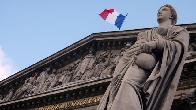 Le drapeau tricolore au dessus de l'Assemblée nationale à Paris [Joel Saget / AFP/Archives]