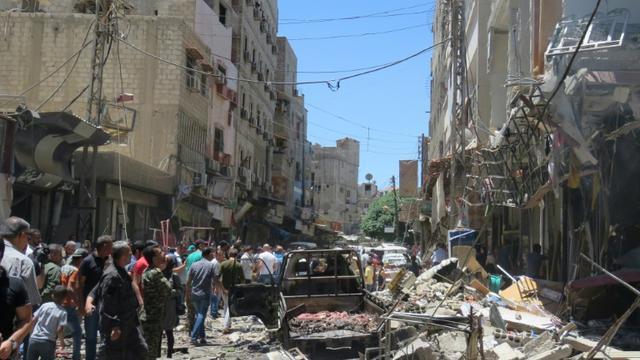 Site d'une double explosion à l'extérieur du mausolée chiite de Sayead Zeinab, près de Damas, le 11 juin 2016 [STRINGER / AFP]