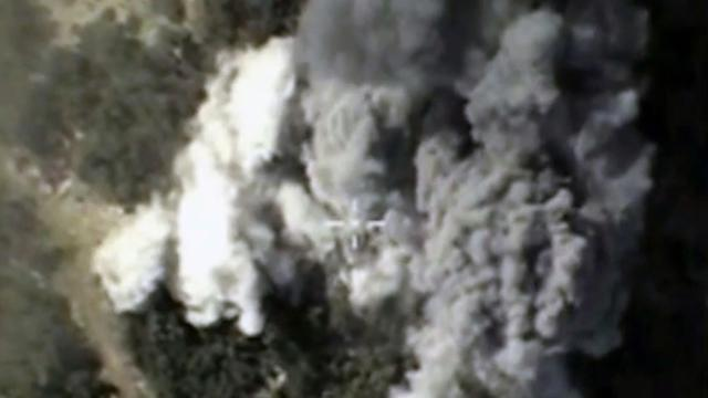 Capture d'écran le 13 octobre 2015 d'une vidéo rendue publique par le ministère de la Défense russe montrant, d'après le ministère, des frappes russes en Syrie [Ho / RUSSIAN DEFENCE MINISTRY/AFP/Archives]