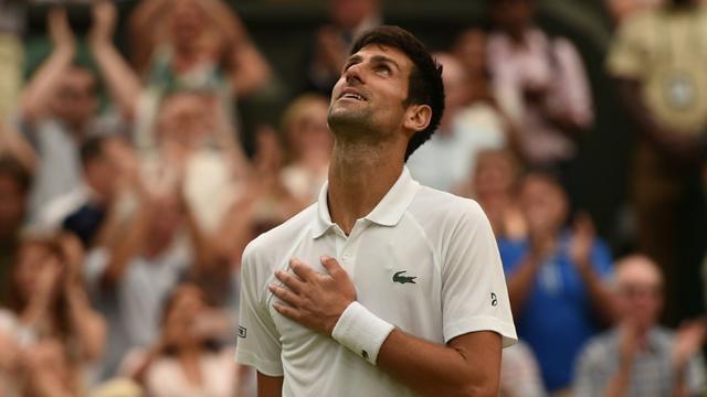 Le Serbe Novak Djokovic se qualifie pour la finale de Wimbledon en battant l'Espagnol Rafael Nadal, le 14 juillet 2018 [Oli SCARFF                           / AFP]