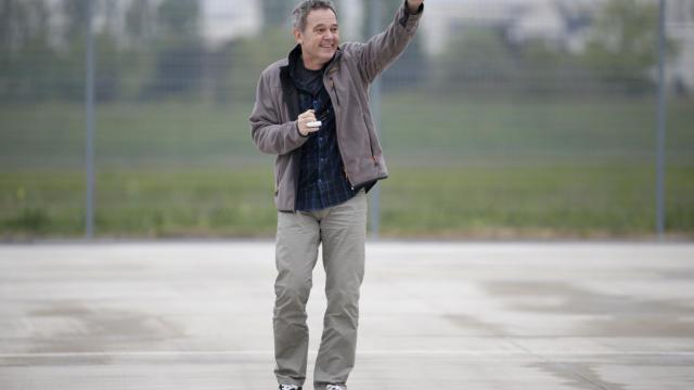 L'ex-otage en Syrie Didier Francois à son arrivée à l'aéroport de Villacoublay le 20 avril 2014 [Kenzo Tribouillard / AFP/Archives]