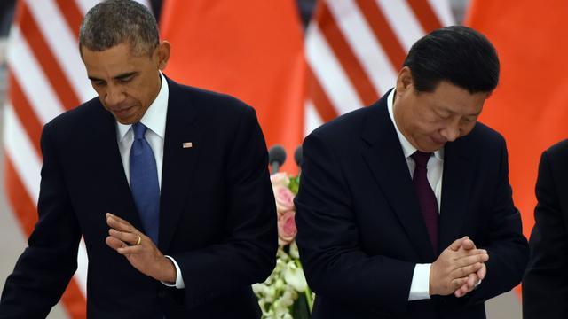 Le président américain Barack Obama et son homologue chinois  Xi Jinping le 12 novembre 2014 à Pékin [Greg Baker / POOL/AFP]