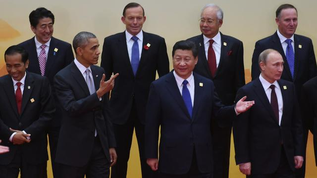 Photo de groupe lors du précédent sommet de l'Apec, en Chine en novembre 2015, avec notamment au premier plan le président américain Barack Obama aux côtés de son homologue chinois Xi Jinping [GREG BAKER / AFP/Archives]