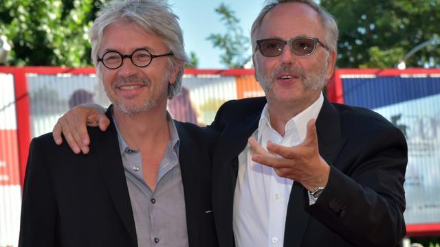 """Christian Vincent (g) et Fabrice Luchini arrive à la présentation du film """"L'Hermine"""" à la Mostra le 6 septembre 2015 [Giuseppe Cacace / AFP]"""
