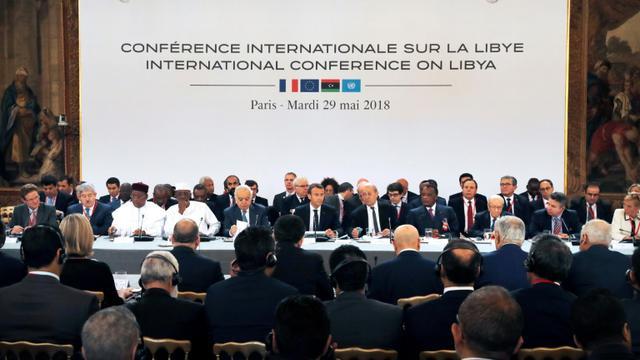 Emmanuel Macron réunit les principaux acteurs du conflit libyen à l'Elysée à Paris, le 29 mai 2018 [Etienne LAURENT / POOL/AFP]