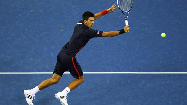 Novak Djokovic s'est taillé un beau costume de favori de l'US Open en battant Juan Martin Del Potro en trois sets pas si secs, jeudi en quart de finale lors d'un match intense et par moments sensationnel. [GETTY IMAGES NORTH AMERICA]