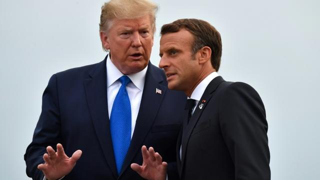 Le président Emmanuel Macron accueille son homologue américain Donald Trump pour un dîner avec les autres dirigeants du G7, le 24 août 2019 à Biarritz [Nicholas Kamm / AFP]
