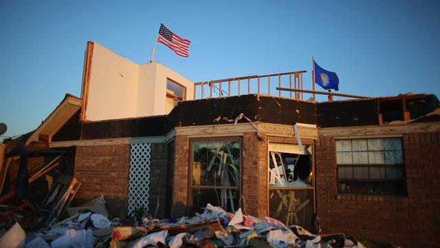 Des décombres après le passage d'une tornarde à El Reno, dans l'Oklahoma, le 1er juin 2013 [Joe Raedle / Getty Images/AFP]