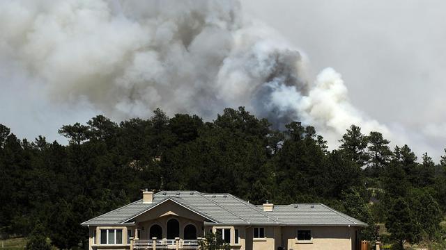 Une habitation menacée le 12 juin 2013 par l'incendie qui ravage le Colorado [Chris Schneider / Getty Images/AFP]
