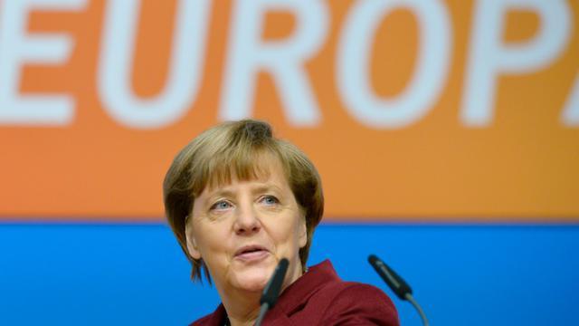 Angela Merkel, le 13 décembre 2015 à la veille du Congrès de l'Union chrétienne-démocrate (CDU), à Karlsruhe, au sud-ouest de l'Allemagne [THOMAS KIENZLE / AFP]