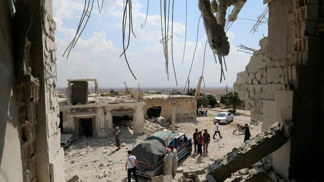 Les destructions après les bombardements du régime syrien sur le village de Hbit dans le sud de la province d'Idleb, le 9 septembre 2018 [OMAR HAJ KADOUR / AFP]