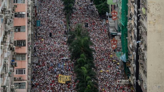 Manifestation contre un projet de loi d'extradition vers la Chine continentale, le 9 juin 2019 à Hong Kong [Philip FONG / AFP]