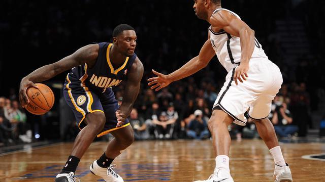 Lance Stephenson (g), des Indiana Pacers, contre les Brooklyn Nets en NBA le 9 novembre 2013 à New York [Maddie Meyer / AFP]