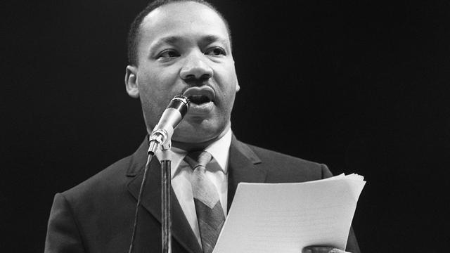 Le pasteur et meneur du combat pour les droits civiques aux Etats-Unis Martin Luther King à Paris le 29 mars 1966 [ / AFP/Archives]