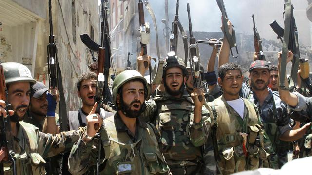 Soldats de l'armée syrienne dans la banlieue de Damas, le 20 juillet 2012 [Louai Beshara / AFP/Archives]