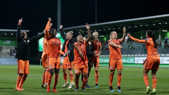 La joie des lyonnaises après avoir éliminé Wolfsburg en quart de finale de la Ligue des champions, le 27 mars 2019 à Wolfsburg [Ronny Hartmann / AFP]