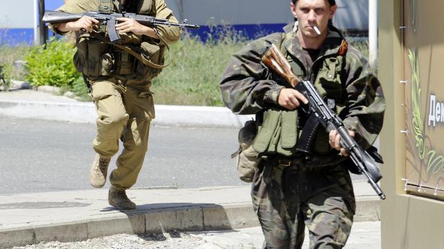 Des rebelles pro-russes lors d'affrontements avec les troupes gouvernementales le 21 juillet 2014 à Donetsk [Alexander Khudoteply / AFP/Archives]