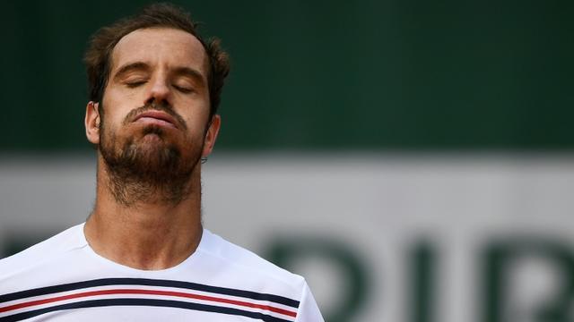 Le Français Richard Gasquet contre l'Argentin Juan Ignacio Londero au 2e tour de Roland-Garros, le 29 mai 2019 à Paris [Anne-Christine POUJOULAT / AFP]