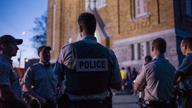 Des policiers au Québec [Ian Willms / Getty/AFP/Archives]