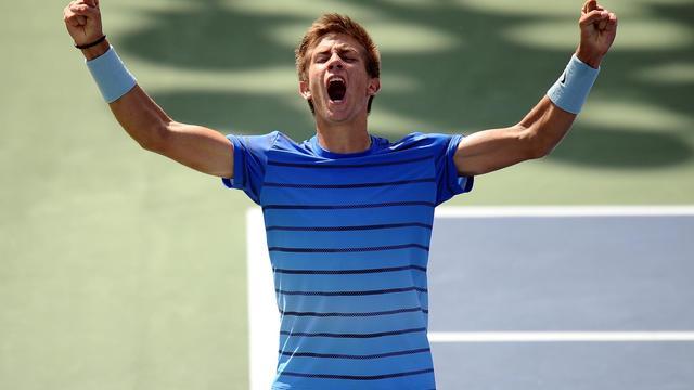 Le jeune Croate Borna Coric exulte après sa victoire sur l'Australien Thanasi Kokkinakis en finale de la catégorie junior à l'US Open, le 8 septembre 2013 à New York [Maddie Meyer / AFP/Archives]