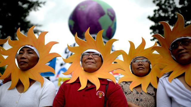 Des manifestants contre le réchauffement climatique, à Manille le 28 novembre 2015 [NOEL CELIS / AFP]