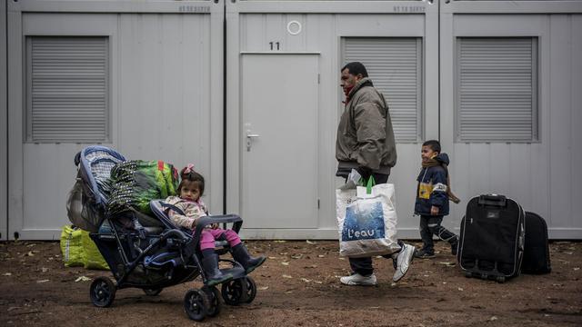 Des demandeurs d'asile albanais dans un camp à Oullins, le 18 novembre 2013 [Jeff Pachoud / AFP/Archives]