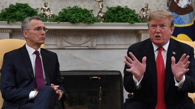 Donald Trump et le secrétaire général de l'Otan Jens Stoltenberg, le mardi 2 avril 2019 à la Maison Blanche [Jim WATSON / AFP]