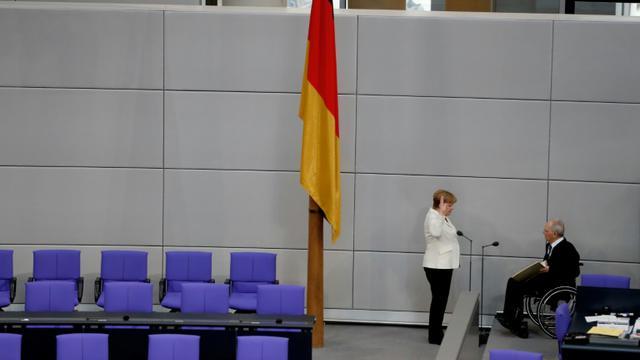 La chancelière Angela Merkel prête serment devant le président allemand Wolfgang Schaueuble, le 14 mars 2018 au Bundestag à Berlin [Odd ANDERSEN / AFP]