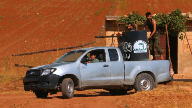Des combattants à bord d'un véhicule armé le 1er septembre 2015 à Marea [ZAKARIYA AL-KAFI / AFP/Archives]