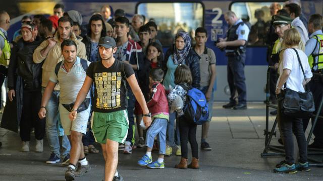 Des réfugiés arrivent en gare de Munich en Allemagne, le 12 septembre 2015 [Philippe Guelland / AFP]