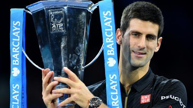 Le Serbe Novak Djokovic après sa victoire dans la précédente édition du Masters de Londres, le 16 novembre 2014 [LEON NEAL / AFP/Archives]