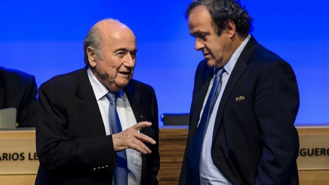 Joseph Blatter et Michel Platini le 11 juin 2014 à Sao Paulo [Fabrice Coffrini / AFP/Archives]