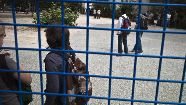Des élèves font leur rentrée scolaire [Jean-Philippe Ksiazek / AFP/Archives]