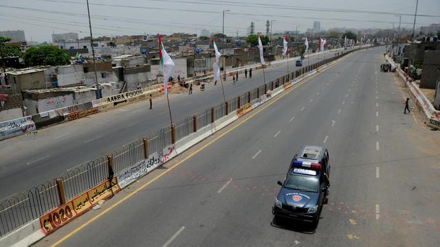 Une voiture de la police pakistanaise [Asif Hassan / AFP/Archives]