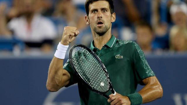 Le Serbe Novak Djokovic face au Bulgare Grigor Dimitrov lors du 3e tour du Masters 1000 de Cincinnati (Ohio), le 16 août 2018  [MATTHEW STOCKMAN / Getty/AFP]