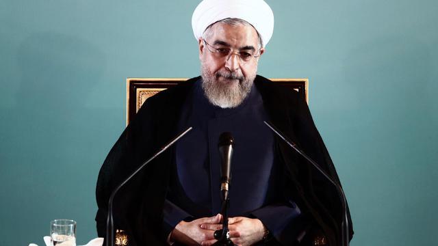 Le président iranien Hassan Rohani en conférence de presse à Téhéran le 30 août 2014 [Behrouz Mehri / AFP]
