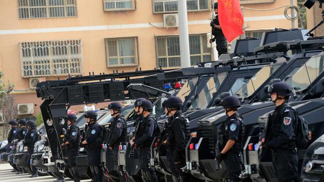 Des forces de sécurité chinoises à Hetian, dans la région musulmane du Xinjiang, dans le nord-ouest de la Chine, le 6 juin 2014 [ / AFP/Archives]