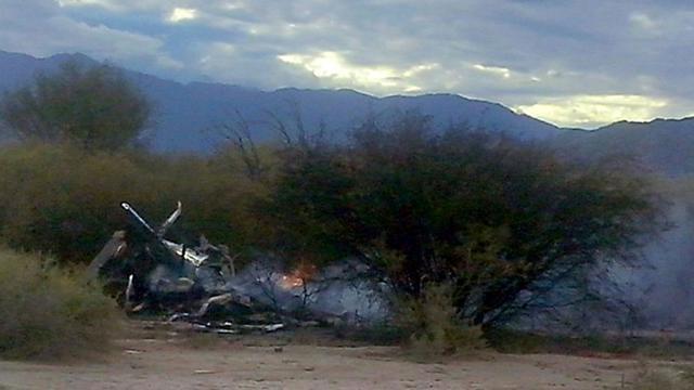 """Photo des hélicoptères détruits dans la collision qui a coûté la vie à 10 personnes sur le tournage de l'émission """"Dropped"""" près de Villa Castelli en Argentine le 10 mars 2015 [ALDO PORTUGAL / AFP/Archives]"""