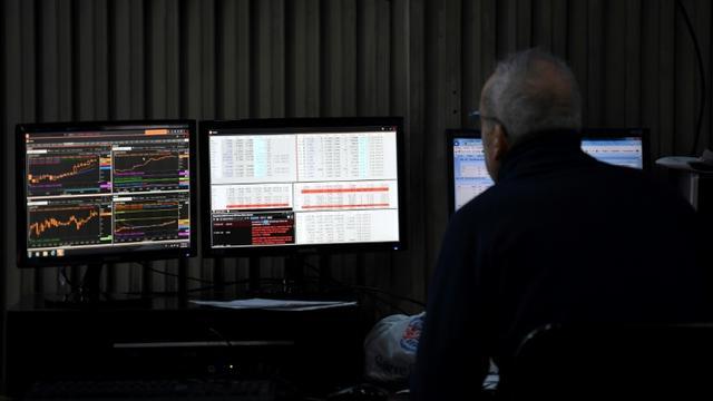 Un tradeur à la bourse de Buenos Aires le 12 août 2019 [RONALDO SCHEMIDT / AFP]